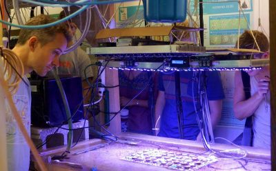 Henderson and students study corals growing in controlled environments