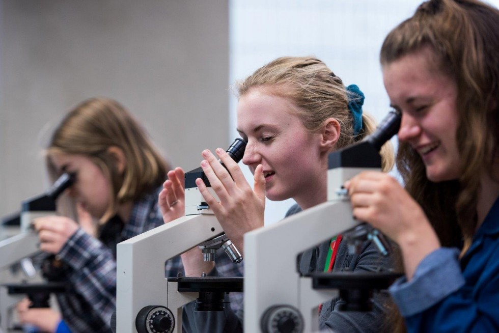 Students with microscopes